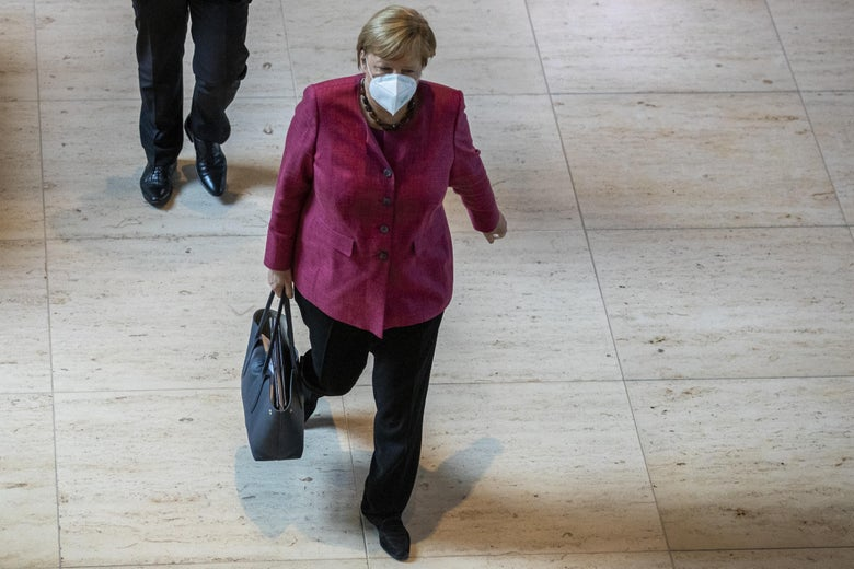 German Chancellor Angela Merkel walks at the Bundestag in Berlin on Thursday