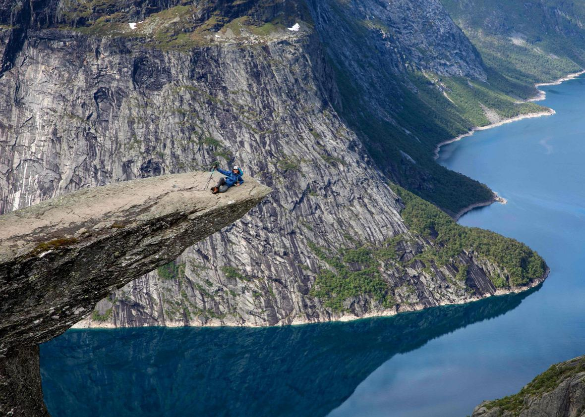 Tourists visit the rock 'Trolltunga' in the county Hordaland in the western part of Norway, on June 21, 2017.