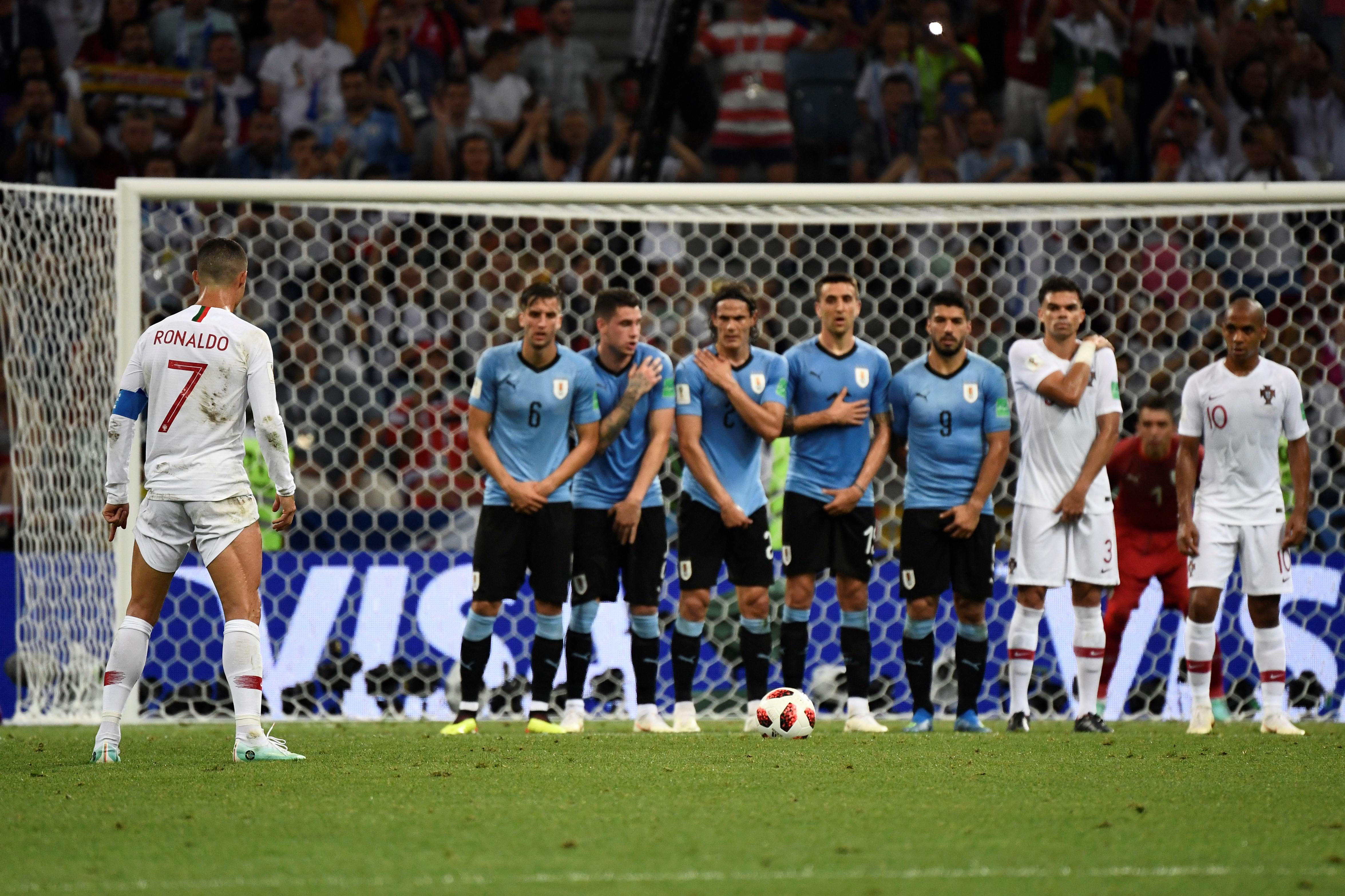 Portugal's forward Cristiano Ronaldo gets ready to kick a free kick.