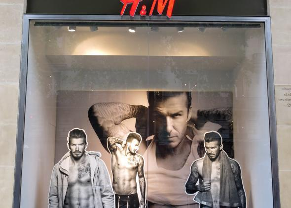 David Beckham clothes models in a store window.