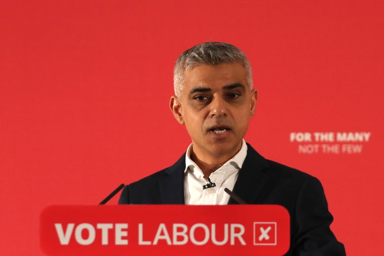 "London Mayor Sadiq Khan at podium reading ""Vote Labour."""