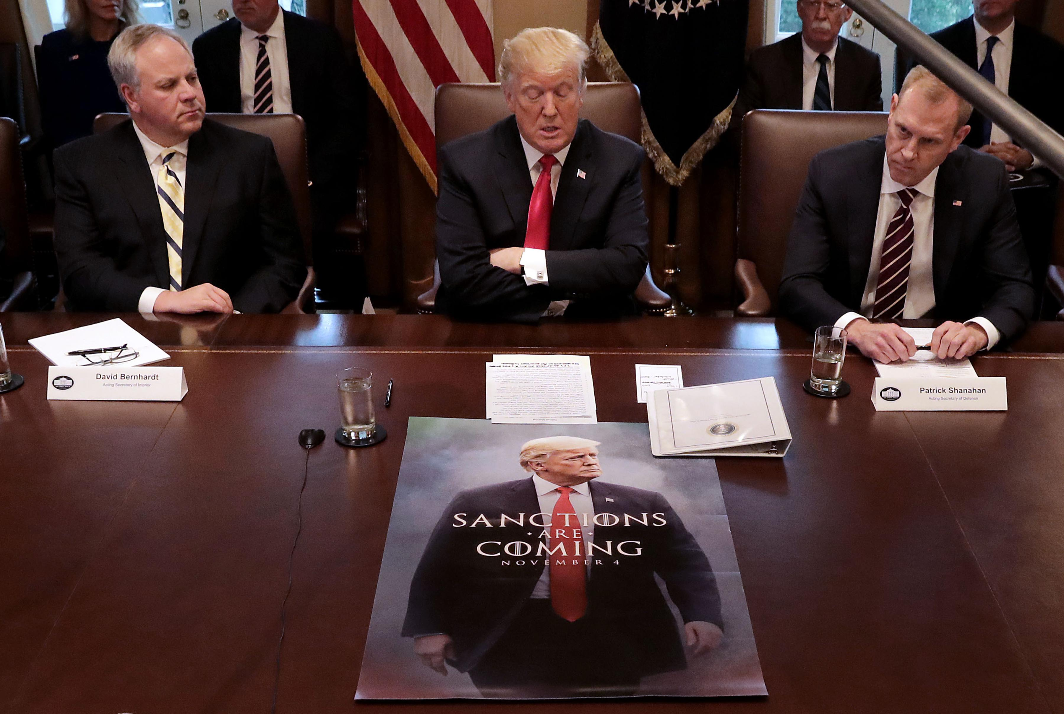 "President Trump sits in front of a Game of Thrones knock off poster during a cabinet meeting after saying earlier he would ""look foolish"" if he opened the government without wall funding."