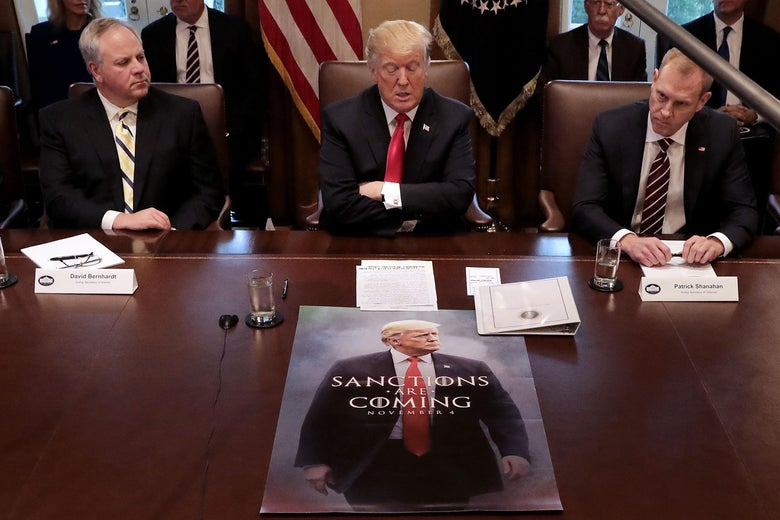 """President Trump sits in front of a Game of Thrones knock off poster during a cabinet meeting after saying earlier he would """"look foolish"""" if he opened the government without wall funding."""