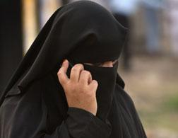 A woman wearing a burqa.