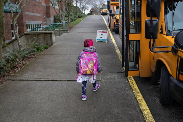 A student leaves the Thurgood Marshal Elementary school after the Seattle Public School system was abruptly closed due to coronavirus fears on March 11, 2020 in Seattle, Washington.