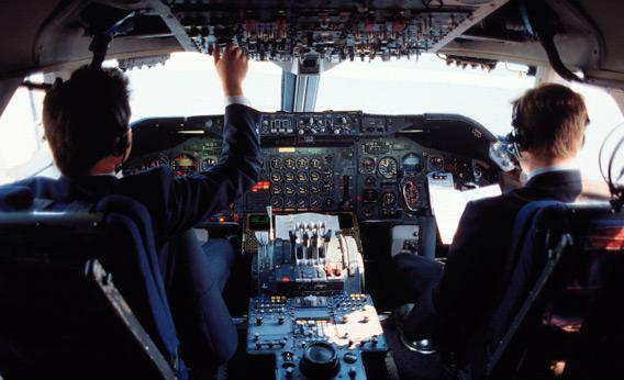 Pilots in cockpit.
