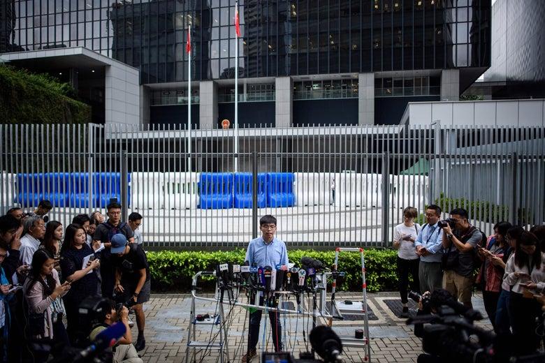 Joshua Wong speaks to media outside the Legislative Council of Hong Kong.