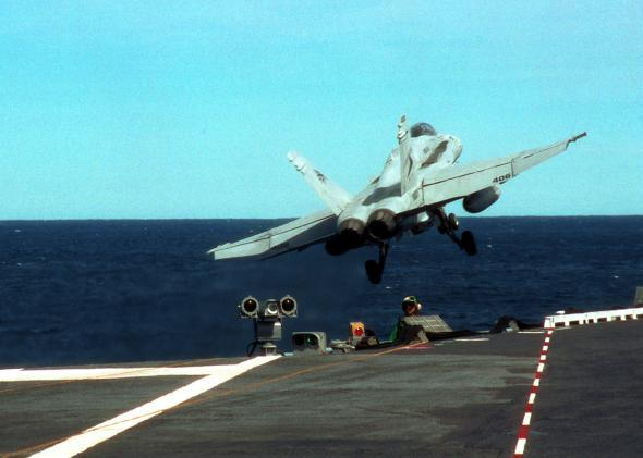 An F/A-18 fighter jet launches from the flight deck of the USS George Washington in 2001 off the coast of New York.