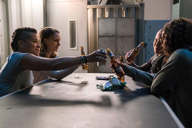 Natalie Portman, Tuva Novotny, Gina Rodriguez, and Tessa Thompson clink beer bottles.