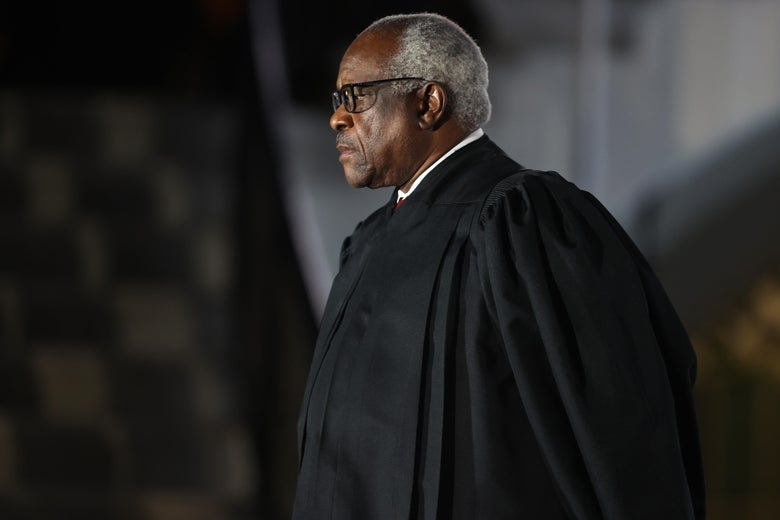 Clarence Thomas wearing his robe and looking serious.