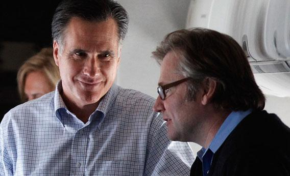 Republican presidential candidate and former Massachusetts Governor Mitt Romney (L) talks with campaign advisor Eric Fehrnstrom (R)