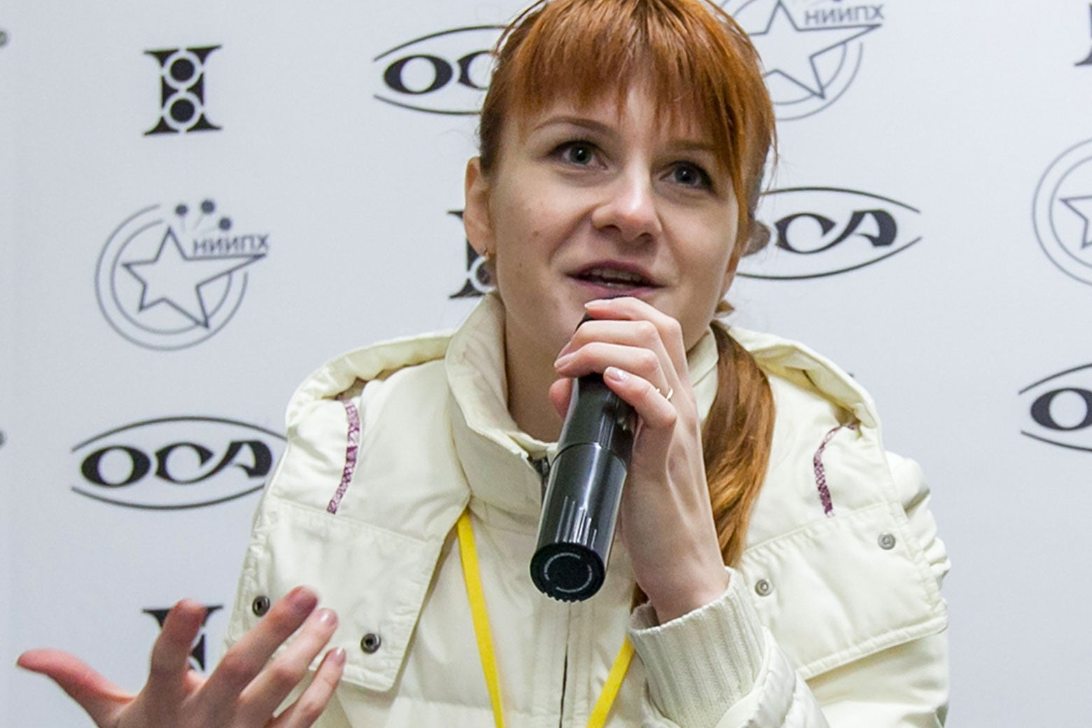 Mariia Butina speaks into a microphone at a press conference.