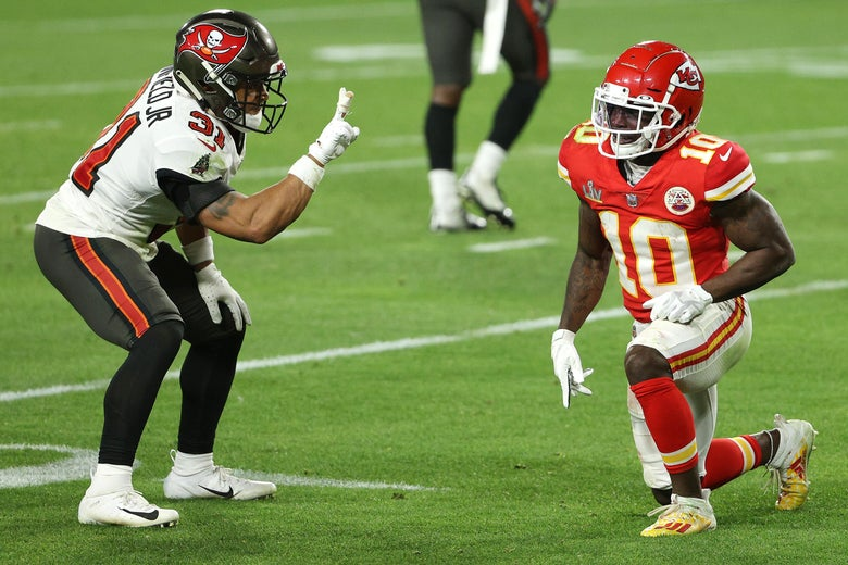Antoine Winfield Jr. raises two fingers in the direction of Tyreek Hill.