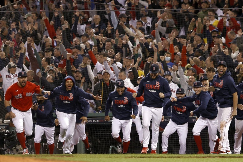 The Boston Red Sox celebrate after beating the New York Yankees 6-2 in the American League Wild Card game at Fenway Park on October 05, 2021 in Boston, Massachusetts.