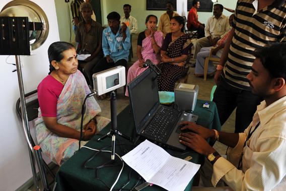 An Indian villager looks at an iris scanner during the data collecting process for a pilot project of The Unique Identification Authority of India (UIDAI) in the village of Chellur, some 145kms north-west of Bangalore on April 22, 2010.