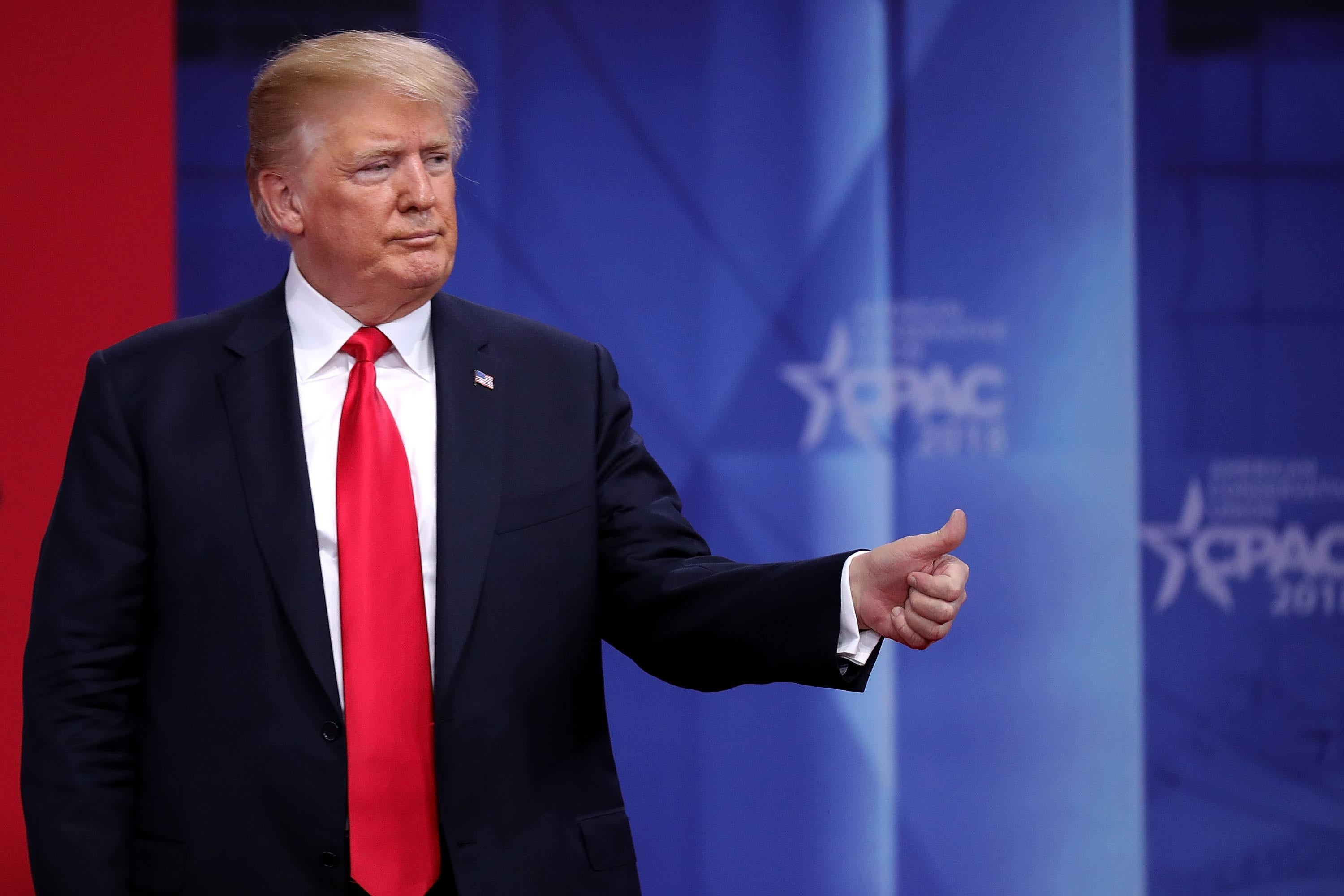 President Donald Trump gives a thumbs-up after addressing the Conservative Political Action Conference at the Gaylord National Resort and Convention Center February 23, 2018 in National Harbor, MD. This was Trump's second year in a row addressing CPAC, the largest convention of political conservatives in the country.