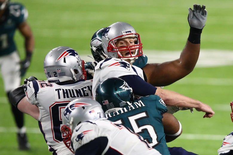 MINNEAPOLIS, MN - FEBRUARY 04: Brandon Graham #55 of the Philadelphia Eagles forces a fumble against Tom Brady #12 of the New England Patriots during the fourth quarter in Super Bowl LII at U.S. Bank Stadium on February 4, 2018 in Minneapolis, Minnesota.  (Photo by Gregory Shamus/Getty Images)