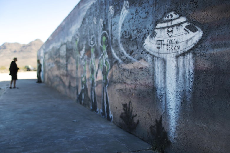 A person looks at a UFO- and alien-themed mural in Hiko, Nevada.