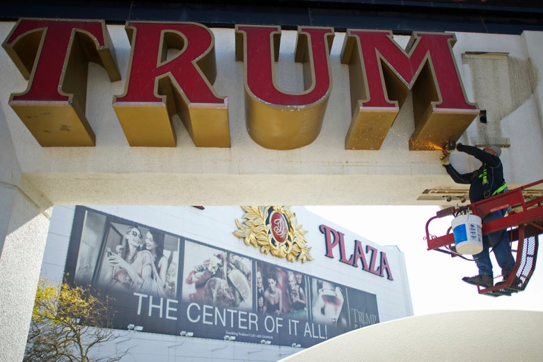 Workers began removing the large letters spelling out the Trump name from the shuttered Trump Plaza casino in Atlantic City.