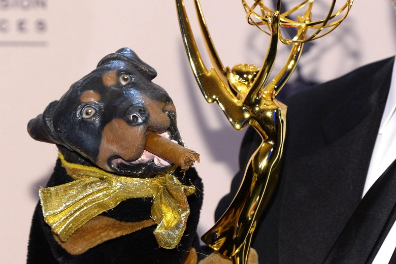 Triumph the Insult Comic Dog, a rubber dog puppet, holding an Emmy.