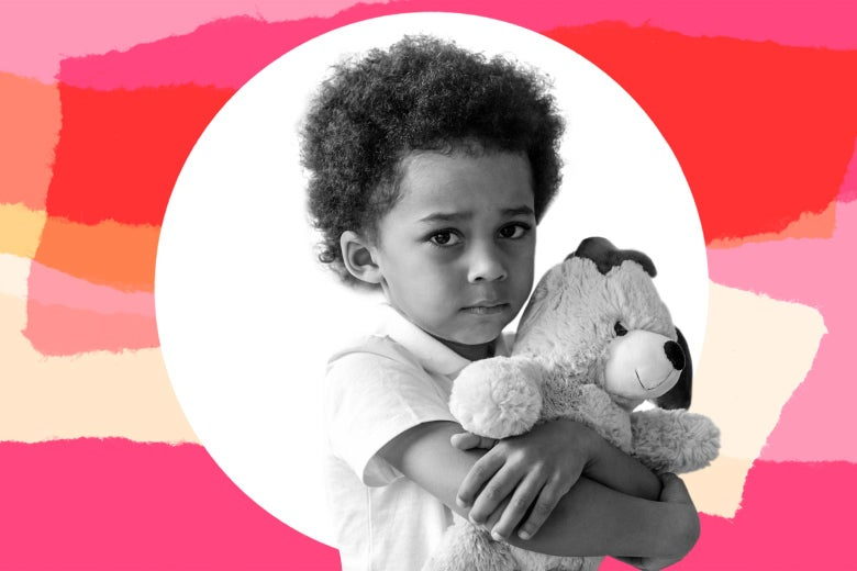 A toddler hugs his teddy bear very tightly and looks stressed.
