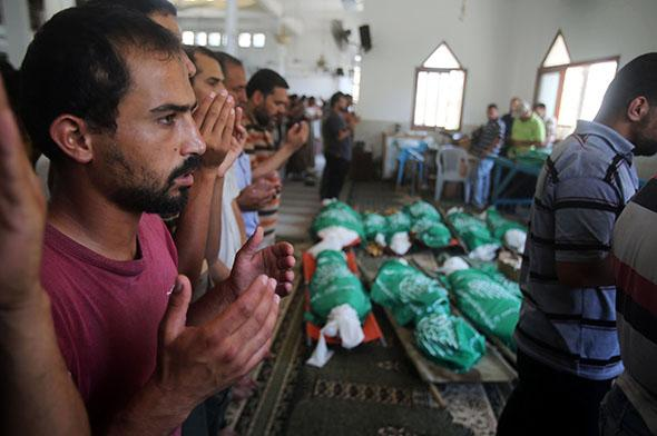 Funeral ceremony is held for the 25 Palestinians killed in Israeli shelling.