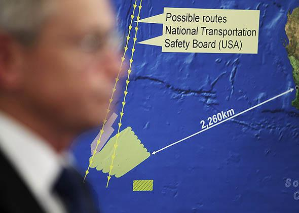 Australian Maritime Safety Authority Emergency Response Division General Manager John Young speaks to the media about satellite imagery of objects possibly related to the search for Malaysian Airlines flight MH370 March 20, 2014 in Canberra, Australia.