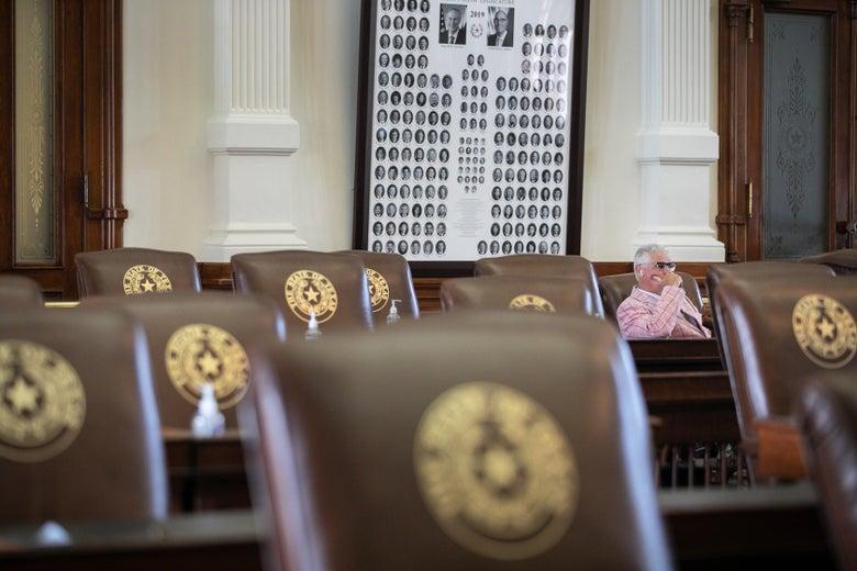 Dan Huberty sits among empty chairs.