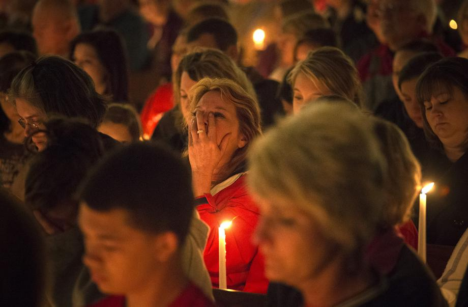 A woman mourns during a candle light church service at St Mary's for victims of a fertilizer plant explosion in the town of West, near Waco, Texas April 18, 2013.