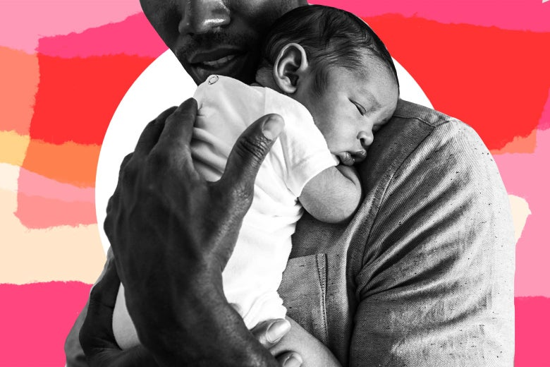 A father holds a sleeping baby to his chest