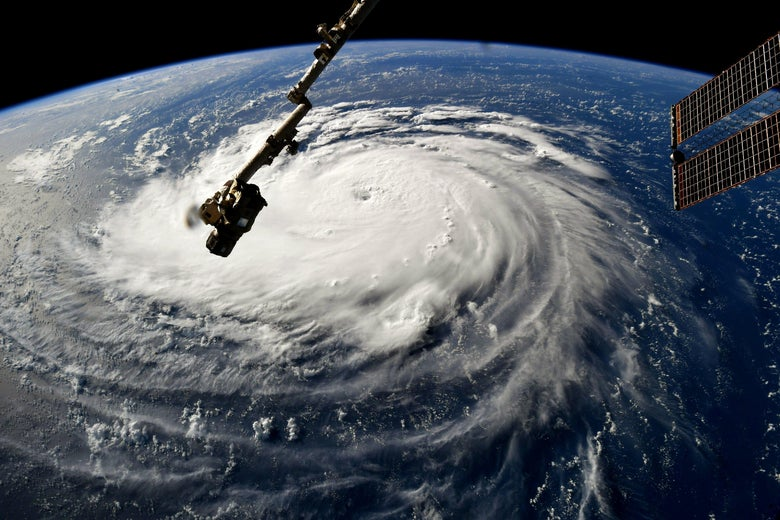 A satellite image of Hurricane Florence, with a part of the International Space Station visible in the foreground.