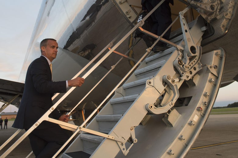 Former campaign aide Corey Lewandowski boards Air Force One prior to departure from Youngstown-Warren Regional Airport in Vienna, Ohio, July 25, 2017, following a campaign rally with US President Donald Trump. / AFP PHOTO / SAUL LOEB        (Photo credit should read SAUL LOEB/AFP/Getty Images)