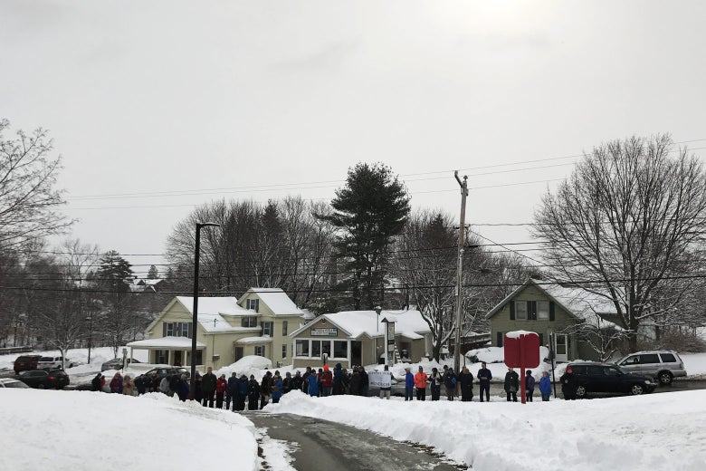 Supporters of the students' demonstration gather on the street outside the high school.