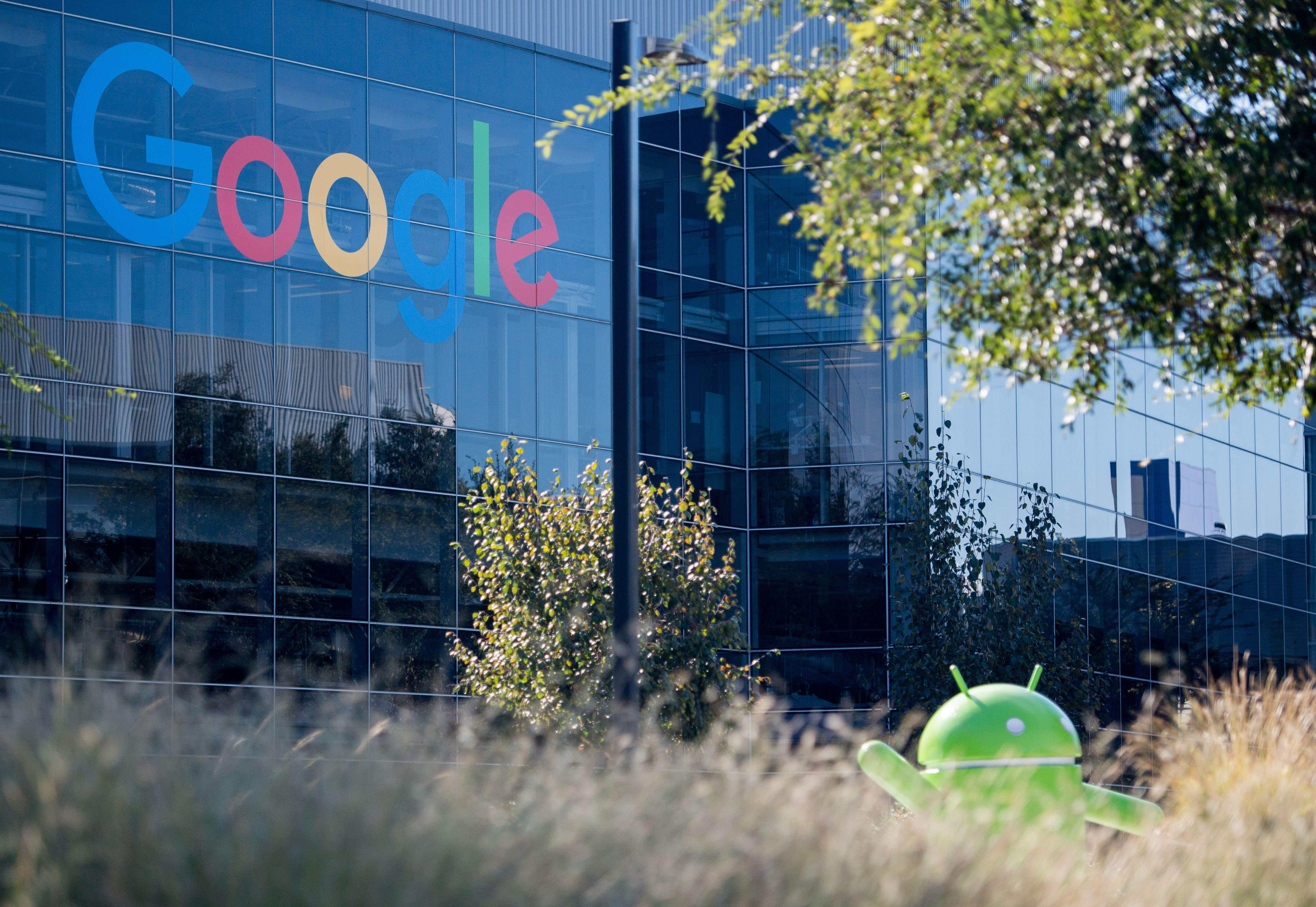 A Google logo and Android statue are seen at the Googleplex in Menlo Park, California on November 4, 2016.  / AFP PHOTO / JOSH EDELSON        (Photo credit should read JOSH EDELSON/AFP/Getty Images)