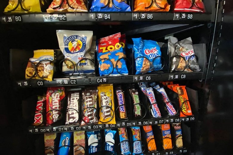 Vending machine filled with a variety of snacks and candy