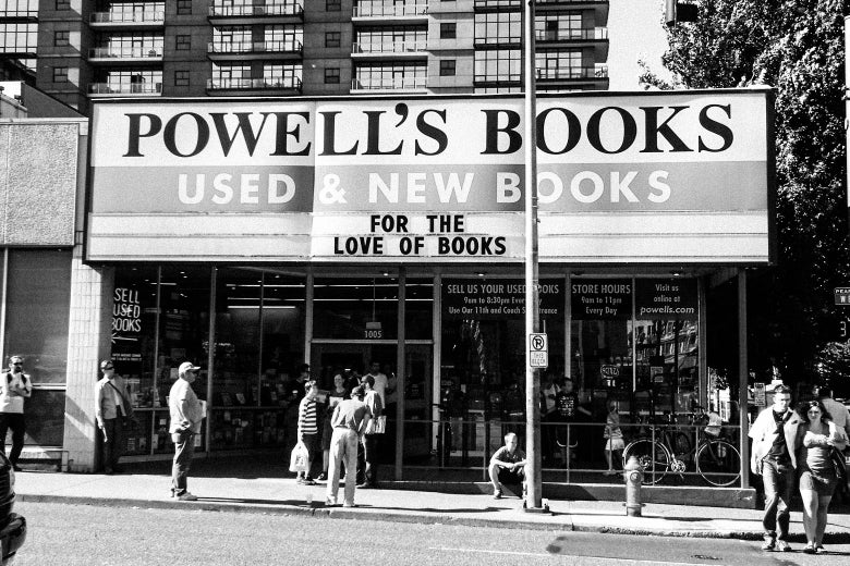 The facade of Powell's Books with people milling outside.