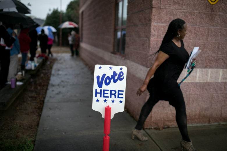 Residents of Charlotte, North Carolina, arrive at a polling station to vote on November 6, 2018.
