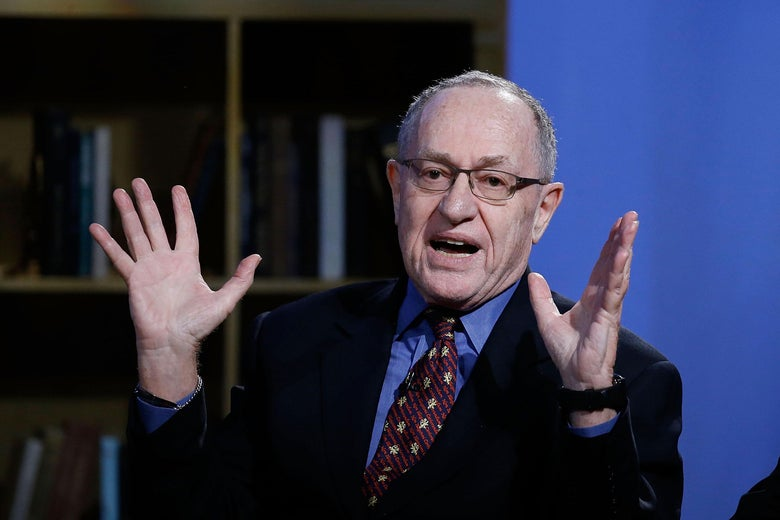 Alan Dershowitz gestures while sitting for an interview.