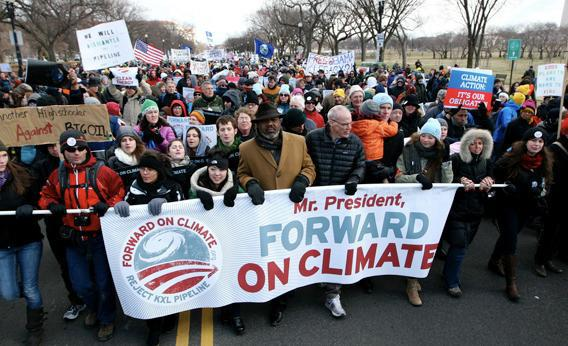 Texas Gulf Coast activist Hilton Kelley (hat, middle) and Bill McKibben lead an estimated 40,000 marchers for the Forward on Climate rally on Feb 17, 2013.