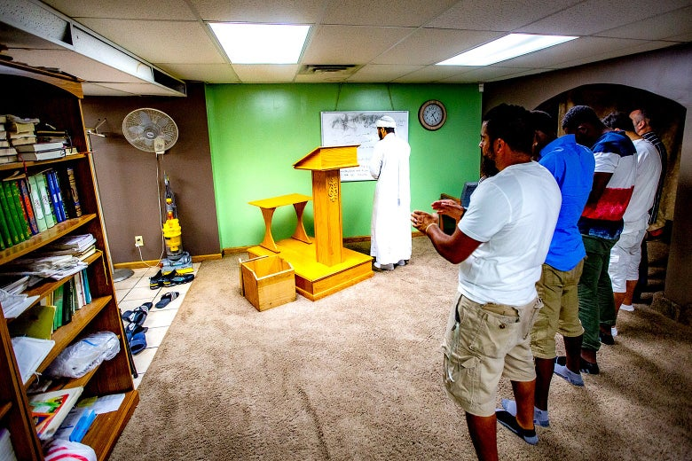 Men pray in CUP Foods' basement mosque.