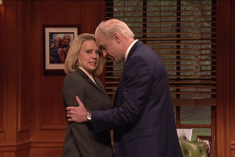 Kate McKinnon grimaces as Jason Sudeikis, as Joe Biden, holds her shoulders and rubs his nose against hers in this still from Saturday Night Live.