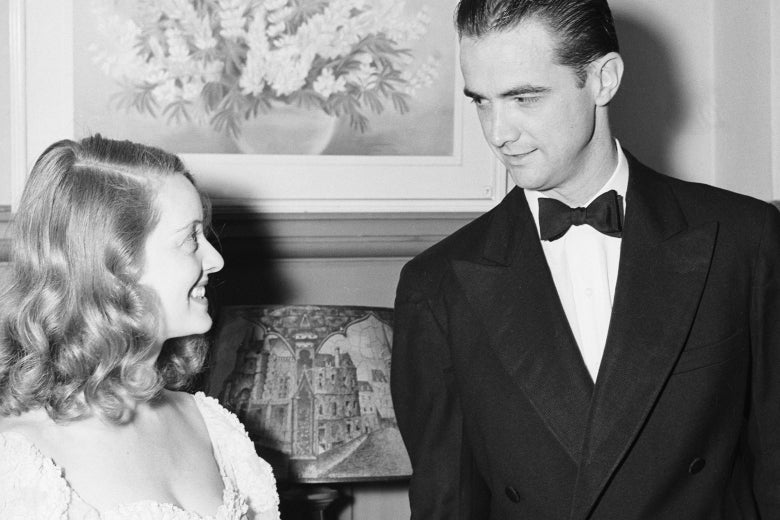 Bette Davis and Howard Hughes looking flirty.