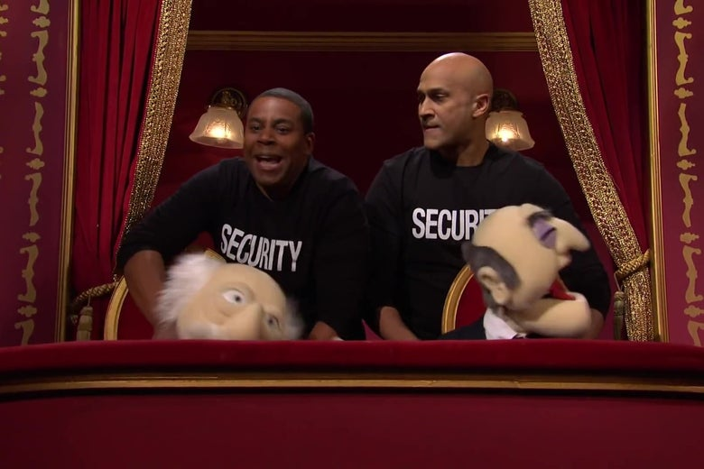 Kenan Thompson and Keegan Michael Key, wearing shirts reading SECURITY, stand behind Statler and Waldorf puppets, strangling them.