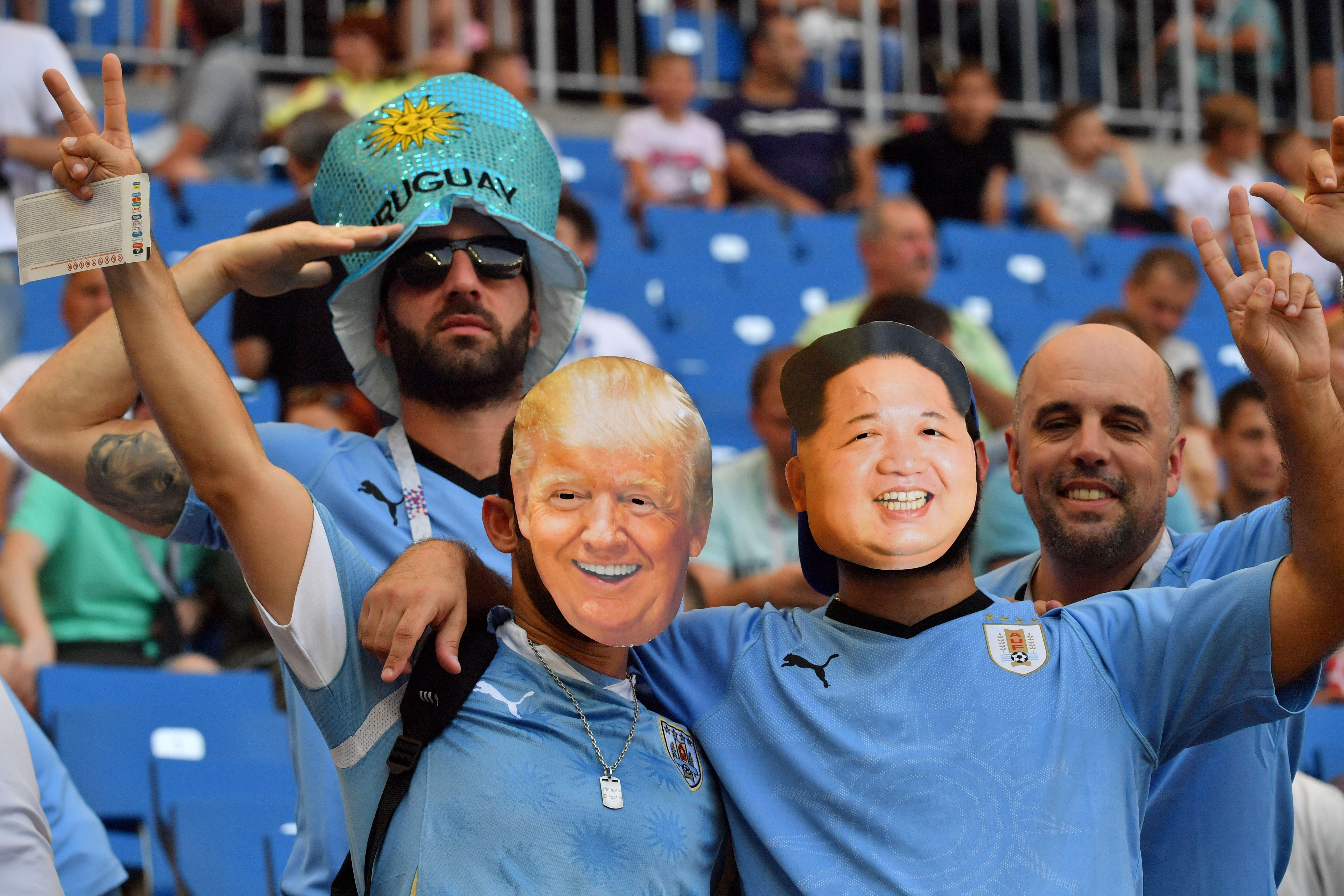 Uruguay fans with paper masks of U.S. President Donald Trump and North Korean leader Kim Jong-un are seen in the crowd ahead of the 2018 World Cup Uruguay–Saudi Arabia match on June 20.