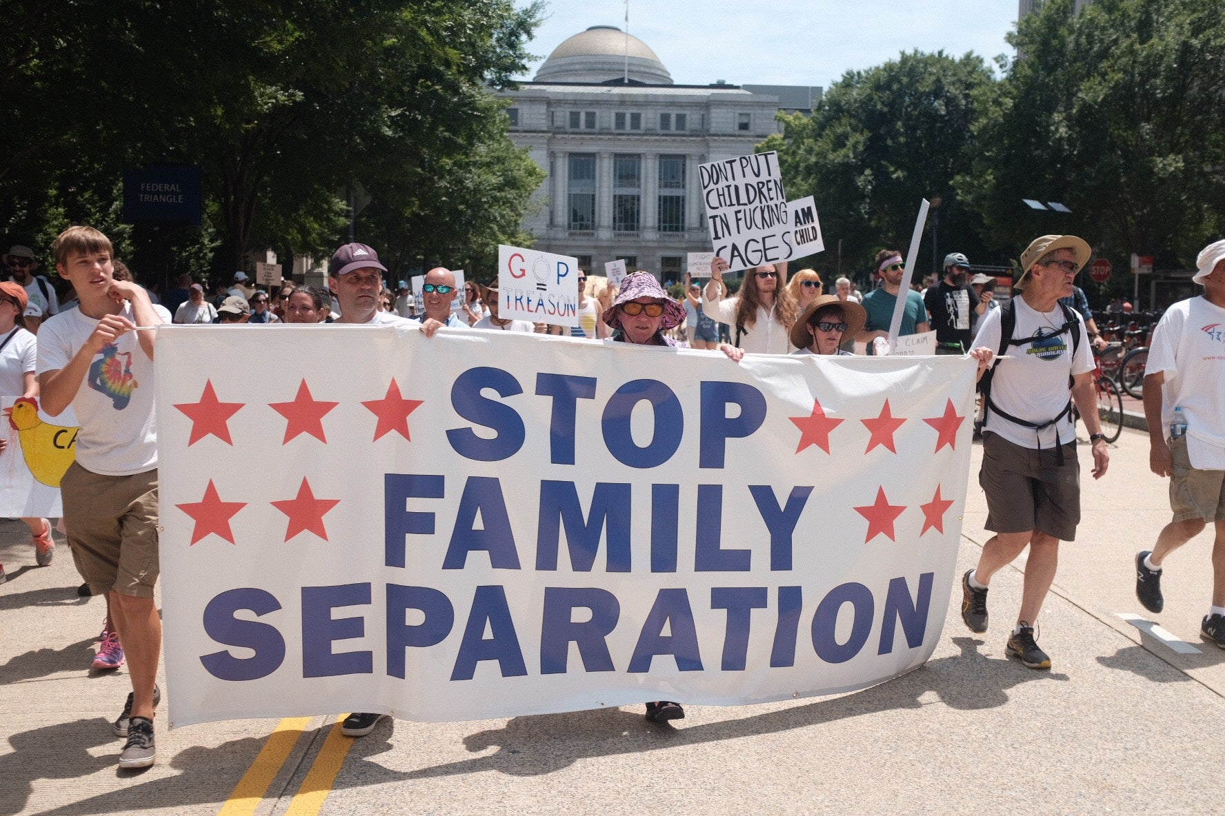 "A banner displaying one the major message of the rally: ""Stop Family Separation."""
