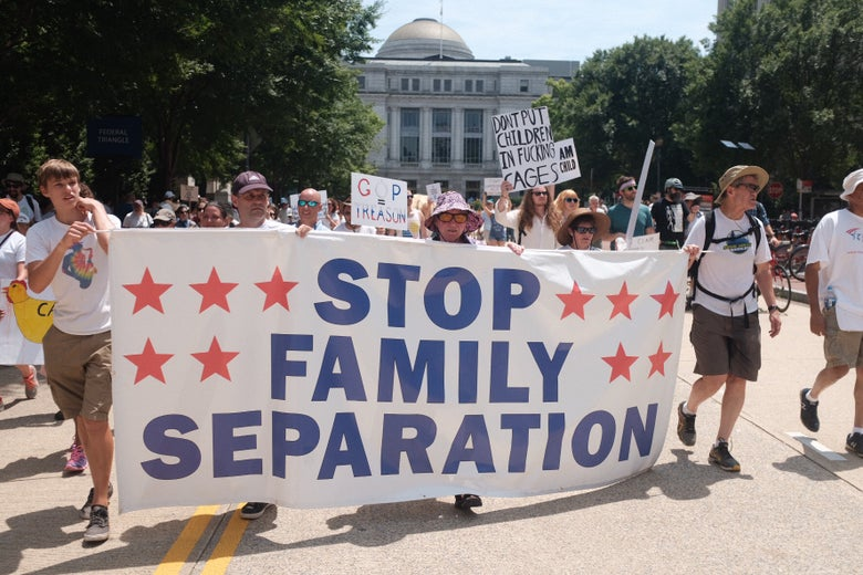 """A banner displaying one the major message of the rally: """"Stop Family Separation."""""""
