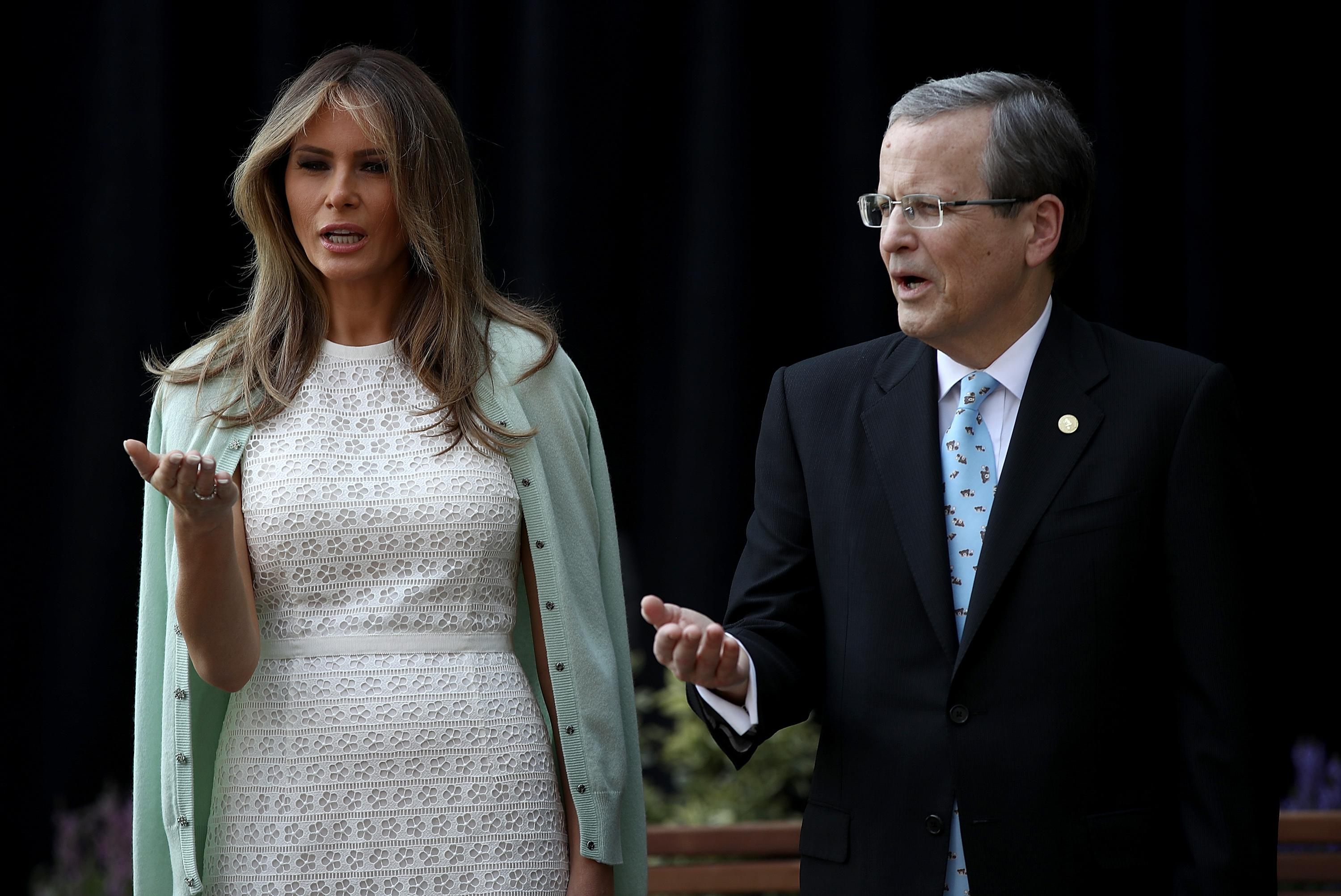 WASHINGTON, DC - APRIL 28:  U.S. first lady Melania Trump takes part in a 'Blessing of the Garden' with Michael Williams (R), chairman of the board, at the Children's National Health System April 28, 2017 in Washington, DC. Trump spoke a the opening of the Bunny Mellon Healing Garden for patients and famlies, an outdoor location for to safely spend time outdoors while receiving treatment at the hospital.  (Photo by Win McNamee/Getty Images)