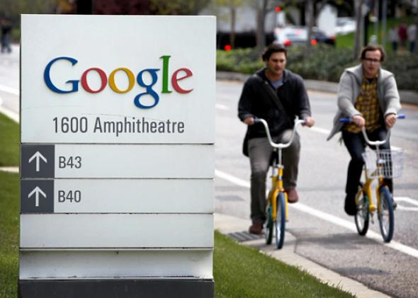 Google workers ride bikes outside of Google headquarters in Mountain View, Calif., April 12, 2012.