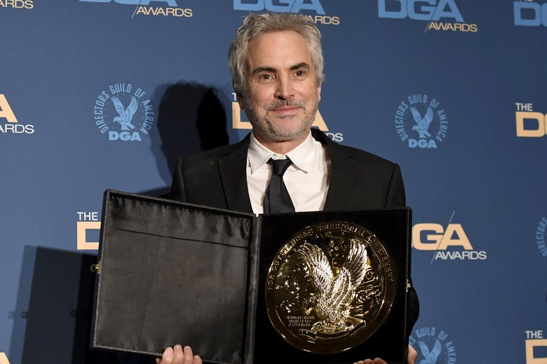 Alfonso Cuarón holding his Directors Guild Award for Roma.