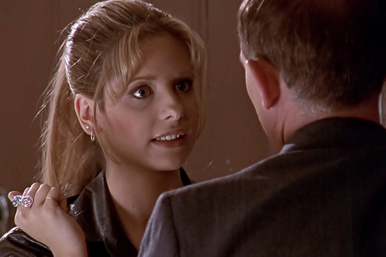 Buffy Summers confronts an older man in a suit.